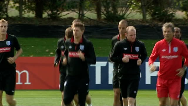 England squad train ahead of Hungary friendly Capello talking to squad / Terry and Lampard along / England players jogging around pitch / England...