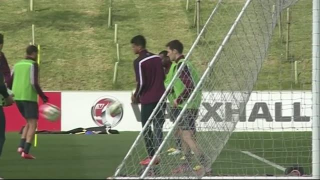 vídeos de stock, filmes e b-roll de england squad training ahead of euro 2016 qualifier more gvs squad warming up and training and hodgson watching - euro 2016