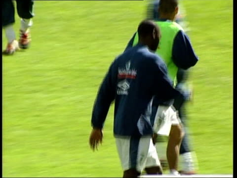 england squad trains in paris; france: paris: stade de france: ext kevin keegan along as players train / andy cole training / paul scoles training /... - michael barry stock videos & royalty-free footage