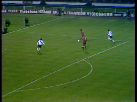 england striker alan clarke wins tackle on edge of penalty area martin chivers passes to tony curry who shoots wide of post during crucial world cup... - internationaler fußball stock-videos und b-roll-filmmaterial