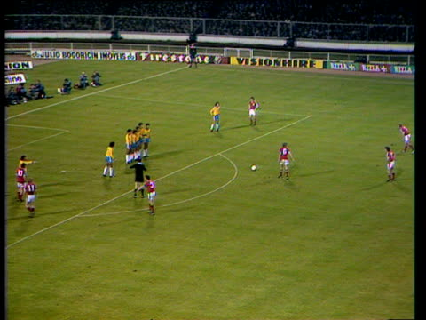 England striker Kevin Keegan scores from freekick with powerful rightfoot shot through defensive wall and grasp of Brazil goalkeeper during...