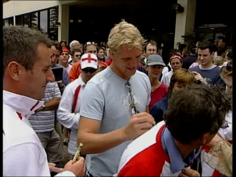 england team celebrate winning world cup england rugby squad signing autographs outside hotel - autogramm stock-videos und b-roll-filmmaterial