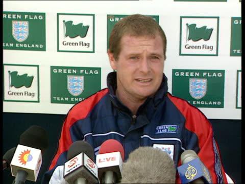 England team gather for training at Bisham Abbey / Paul Gascoigne hits back at press ITN Berks Bisham Abbey EXT Paul Gascoigne drinking from water...