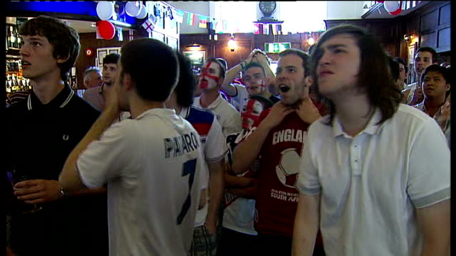 england team return home england essex wanstead int england football fans watching 2010 world cup germanyengland football match in pub ext england... - fifa world cup 2010 stock videos & royalty-free footage