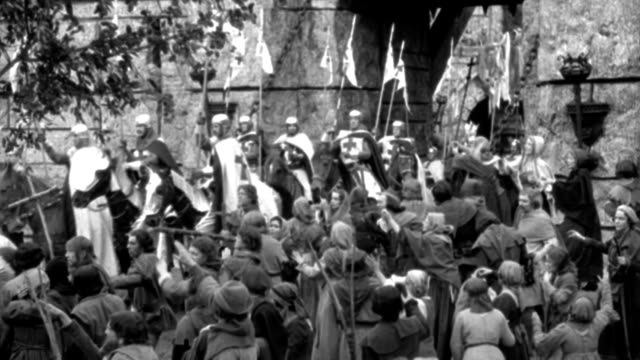 dx - england: the crusaders leave windsor castle - 1190 - h.c.s. - over heads populace toward gate winsdor - procession out of it as - at end procession are the knights hospitaler, visors down, wearing black capes with crosses - b&w. - boundary stock videos & royalty-free footage