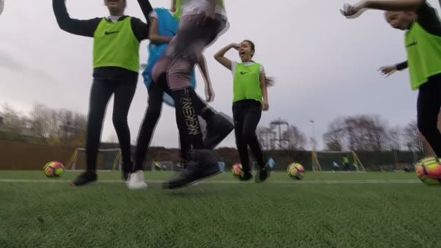 england to host women's euro 2021 tournament / need for further grass roots funding; england: manchester: stanley grove primary school: ext young... - grass stock videos & royalty-free footage