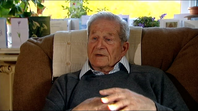 england to review 111 telephone service; west sussex: hove: reporter sat on sofa talking to michael anthony who had a bad experience with the 111 nhs... - worthing点の映像素材/bロール