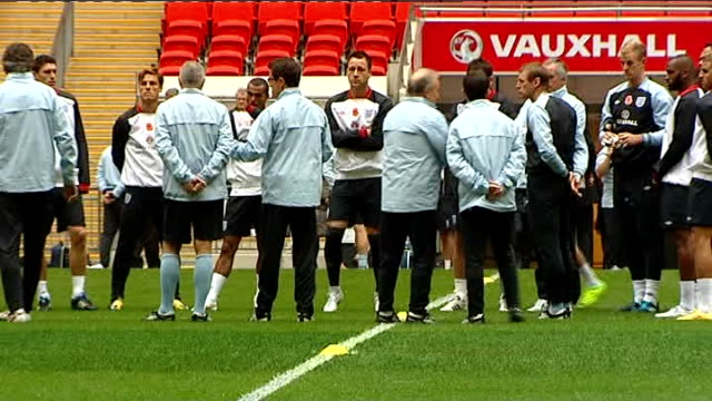 England train at Wembley ahead of match against Spain 'Wear your poppy with pride' hoarding PAN to England team / Silence ends players move / Back...
