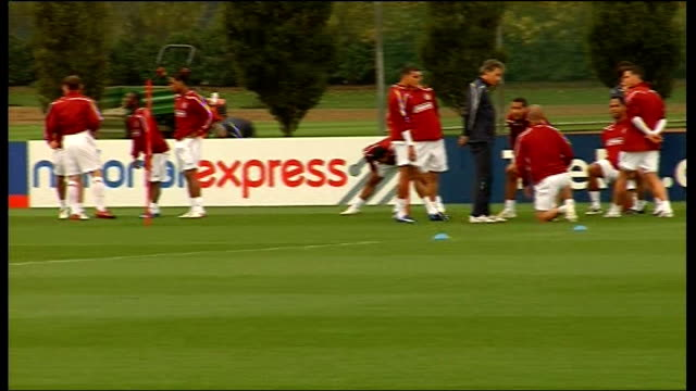 england training ahead of upcoming matches against kazakhstan and belarus wide shot of england players stretching / more shots of england players... - national team stock videos & royalty-free footage