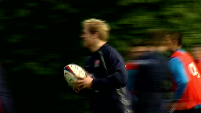 england training delon armitage / team huddle / players training including james haskell tom croft and simon shaw / reporter to camera / brian smith... - croft stock videos & royalty-free footage