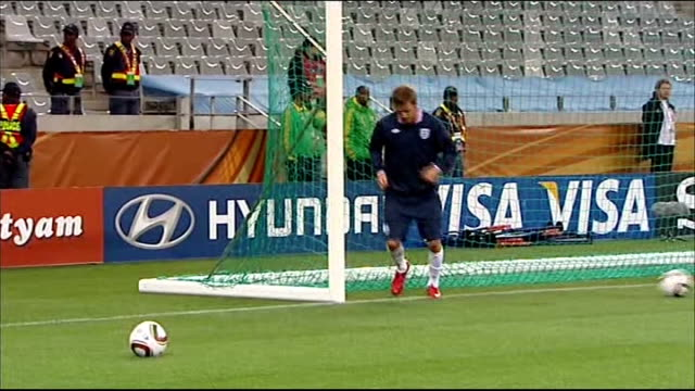 England training prior to Algeria match Capello with coaching team David Beckham collecting up balls Players stretching Jamie Carragher and Joe Cole...