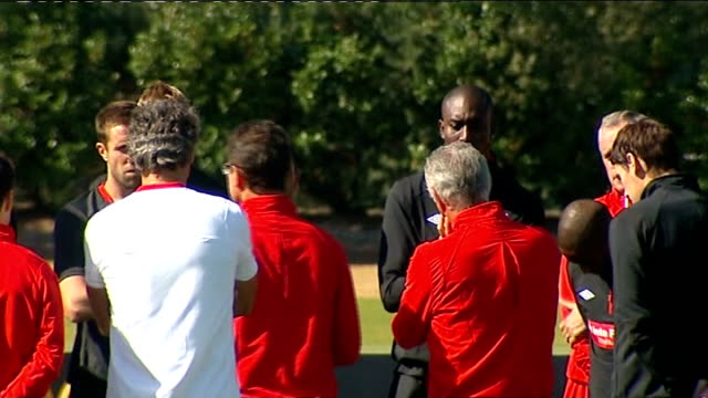 england training session general views general view england players gathered around for team talk / general view joe hart listening pan others... - dawson city stock videos and b-roll footage