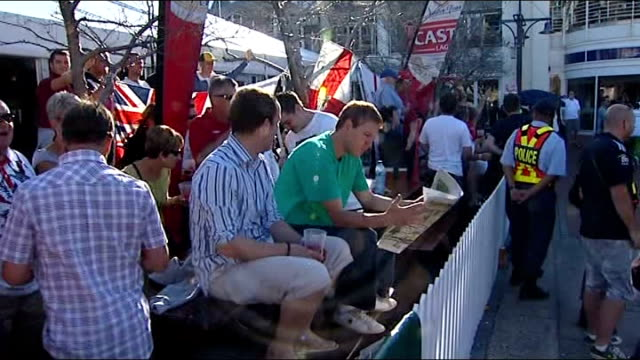 england v algeria preview ext england football fans/supporters cheering and singing outside bar drinking pints of lager england fans with giant flag... - 2010 stock videos & royalty-free footage