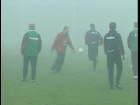 England v Australia preparations aEEN London EXT England Rugby Union players training in foggy conditions Players peforming stretching exercises...