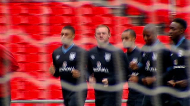 England training session at Wembley Wide shot England players standing on pitch / Jordan Henderson chatting with Danny Welbeck / Players standing and...