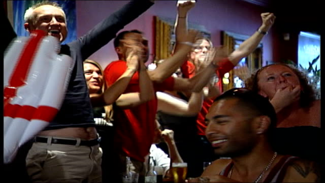 England v Ecuador Fans' reactions London Islington INT Fans in pub as leap up cheering ZOOM IN couple hugging PAN fans clapping SOT Female fan making...