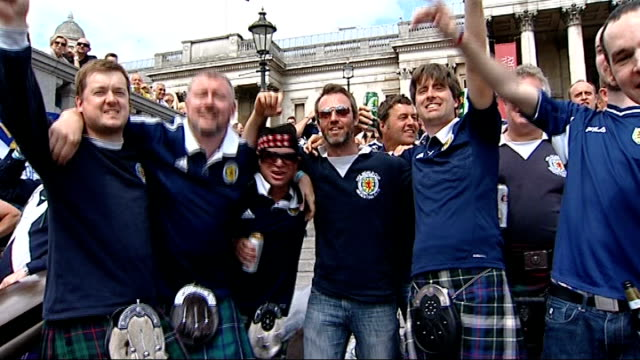 england v scotland friendly; scotland fans singing 'wembley', cheering and waving flags group of scottish fans with arms around each other singing... - kilt stock videos & royalty-free footage