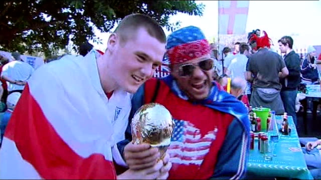 england v usa: build-up; south africa: rustenburg: ext england fans drinking beer at barbecue event in lucky's bar england fans with flag - 'fishcake... - ブラスバンド点の映像素材/bロール