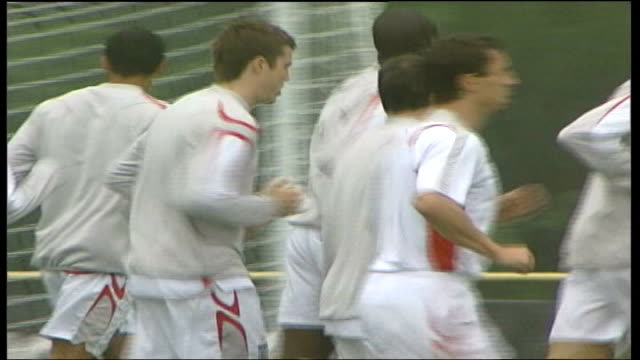 england vs portugal quarter final preview; germany: baden-baden: ext back view of england team listening to sven-goran eriksson at training long shot... - other stock videos & royalty-free footage