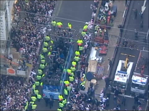 England win World Cup London Victory parade ITN ENGLAND London EXT / MUTE AIR VIEWS Crowds amassed at Oxford Circus for Rugby World Cup players...