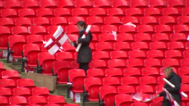 london wembley wembley stadium ext 'w' written on seats pan 'wembley' / women putting england flags on seats / groundsman pushing lawnmower 'wecome... - wembley stock videos & royalty-free footage