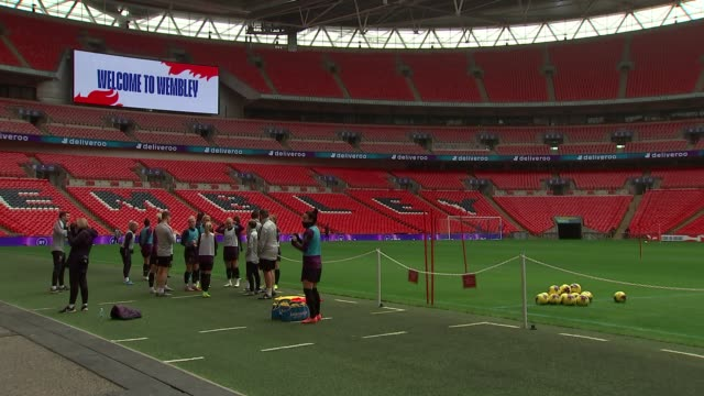 london wembley wembley stadium ext 'welcome to wembley' on screen / england women's team along to pitch / beth england and steph houghton and others... - running stock videos & royalty-free footage