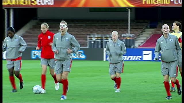 england women's football team training prior to uefa women's final 2009; finland: helsinki: ext members of england women's football team on pitch for... - finland stock videos & royalty-free footage