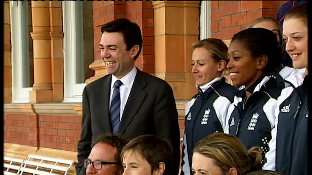 england women's team return home after becoming world cup cricket champions england women's cricket team posing with world cup trophy / andy burnham... - cricket team stock videos & royalty-free footage