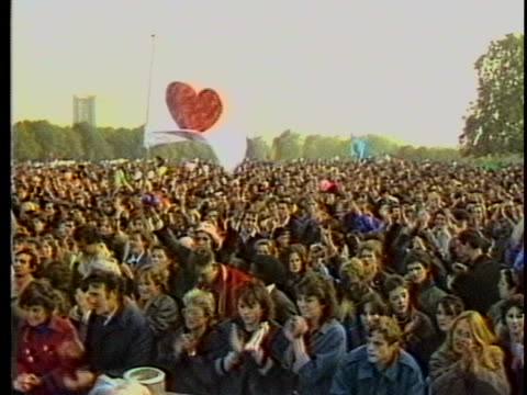 england-anti nuke protesters cheering and clapping. there is an opening medium shot of a crowd of people with a picket sign of a red heart on white... - nuclear energy点の映像素材/bロール