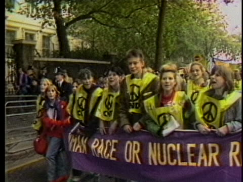 england-anti nuke protesters with banner and pickets. there is a medium shot of multiple people holding up a long purple banner with yellow words.... - nuclear weapon stock videos & royalty-free footage