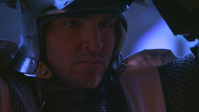 englandknight closing face shield on helmet - traditional armor stock videos and b-roll footage