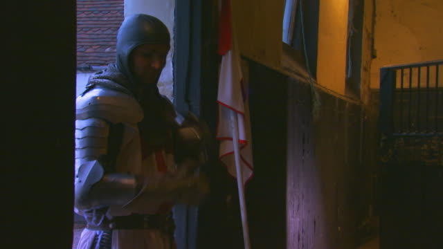 englandknight putting on coif and helmet - traditional armor stock videos and b-roll footage