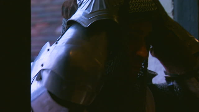 englandknight putting on head gear and helmet - traditional armor stock videos and b-roll footage