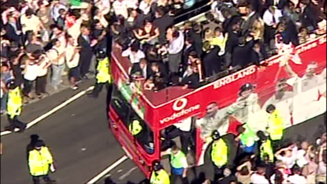 england's ashes winning players celebrate their victory with fans. shows exterior shots the england bus arriving in west london & driving to... - ashes test stock videos & royalty-free footage