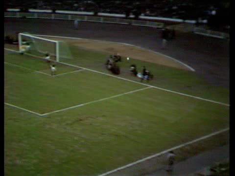 stockvideo's en b-roll-footage met england's bobby charlton in his 100th appearance takes right foot corner kick striker martin peters scores with header inside crowded penalty area... - number 9