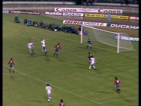 england's bryan robson loops cross into penalty area spain defender antonio maceda heads clearance to england midfielder glenn hoddle who strikes... - internationaler fußball stock-videos und b-roll-filmmaterial