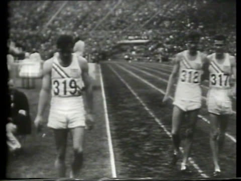 england's king george vi and queen elizabeth ii attend the 1948 london olympics at wembly stadium / male athletes compete in the 110 meter hurdles... - 1948 stock-videos und b-roll-filmmaterial