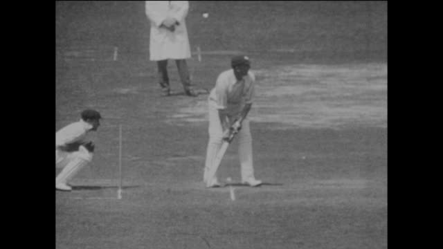england's opening batsmen jack hobbs and herbert sutcliffe are shown in action during the 2nd ashes test match between england and australia at... - テストクリケット点の映像素材/bロール