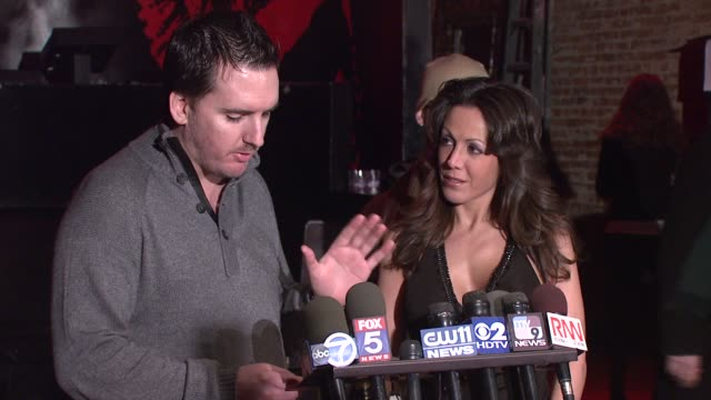 englebert introduces amy fisher with a champagne toast at the amy fisher and lou bellara host press conference for 'amy fisher caught on tape' at... - amy fisher caught on tape stock videos and b-roll footage