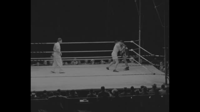 english and american boxers march across field at yankee stadium / wider view of boxers walking across field / referee gene tunney former heavyweight... - heavyweight stock videos and b-roll footage