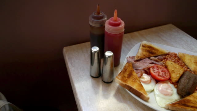 english breakfast on a cafe table - salt shaker stock videos and b-roll footage