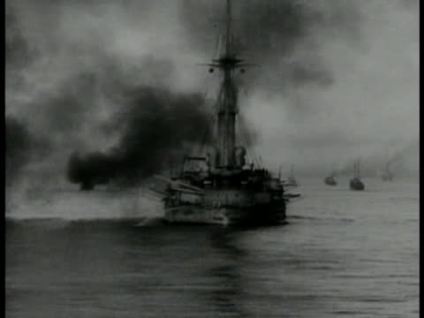 english cannons firing bg ws german ship on fire smoke vs cannons firing from ship deck world war i wwi - erster weltkrieg stock-videos und b-roll-filmmaterial