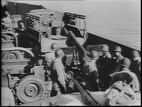 english channel / men climb over side of ship and down cargo net / soldiers board landing barge at side of ship / aerial footage of landing barges at... - sea channel stock videos and b-roll footage