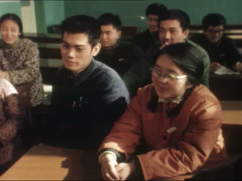 """english class at peking university; china: peking university: ext cms brunson: sof: """"only now...ten years"""" int english teacher mrs chen pull out... - only girls stock videos & royalty-free footage"""
