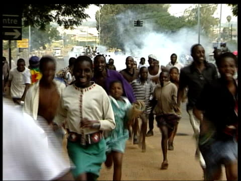 Concerns over Mugabe regime LIB ZIMBABWE Harare People running as riot police firing tear gas into crowd of demonstrators England cricketers...