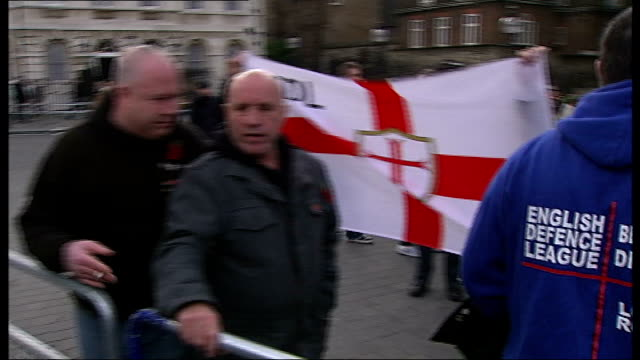 english defence league demonstration in westminster; england: london: westminster: ext various shots of english defence league protest outside houses... - sleeve stock videos & royalty-free footage