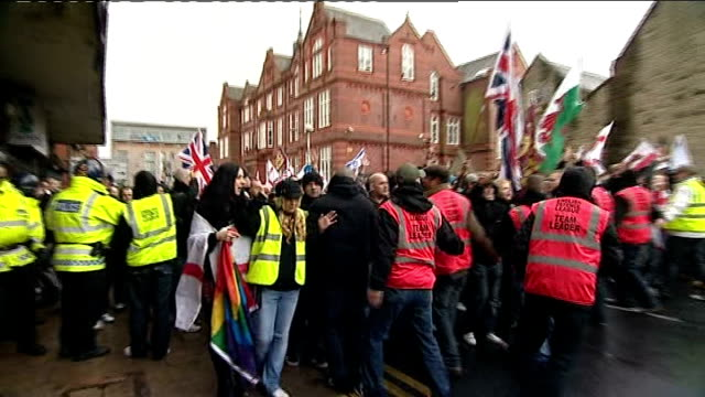 english defence league rally clash with antifascist protesters police forming line in front of marching protesters english defence league supporter... - play fight stock videos and b-roll footage