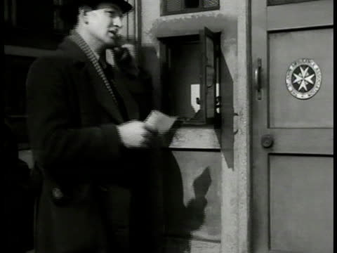 english detective approaching 'police box' telephone booth. detective using telephone. int scotland yard detective at desk answering phone taking... - telephone box stock videos & royalty-free footage