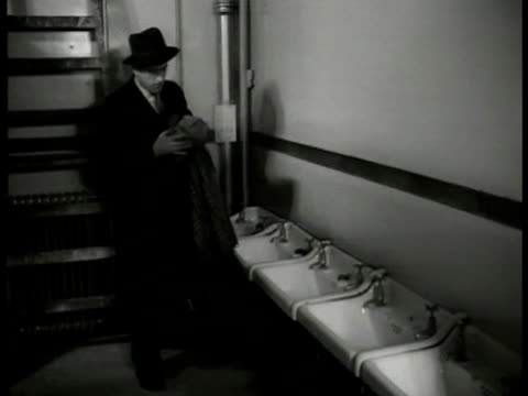 dramatization investigation english detective searching wash room finding burberry raincoat in trash w/ scarf vs detective showing 'inspector finch'... - 1949 stock videos & royalty-free footage