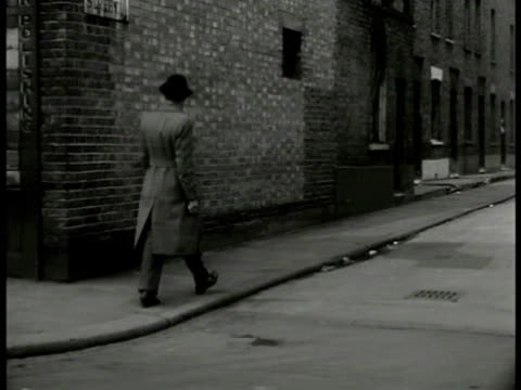 english detective walking down london street around corner vs detective coming to door knocking int ms 'mrs mead' reading magazine smoking cigarette... - detective stock videos & royalty-free footage